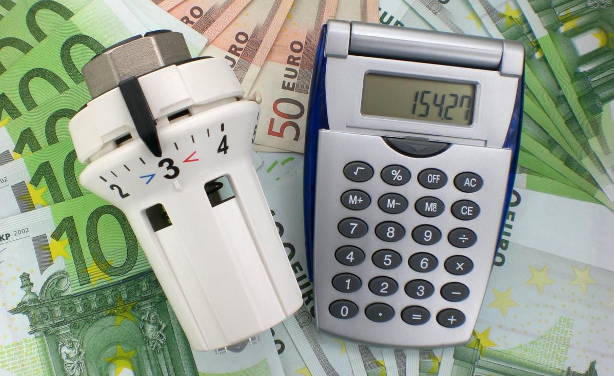 Heizungsregler, Geld, Taschenrechner