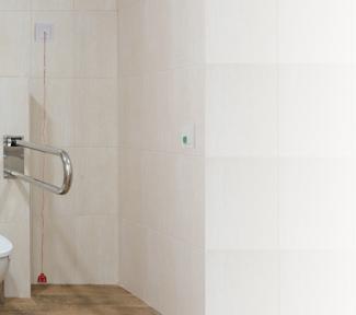 Neuerung für mehr Sicherheit im Bad: Kopp führt WC-Notrufset für Schalterprogramm HK07 ein